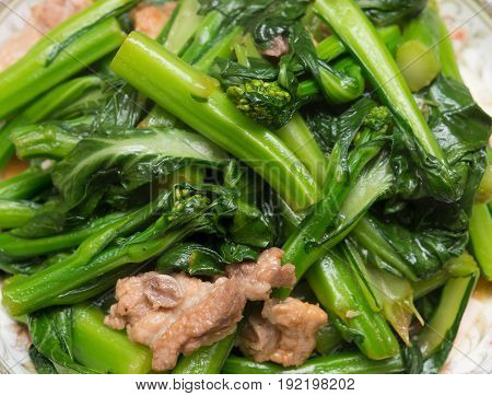 dish of home cooked pork chops with vegetable