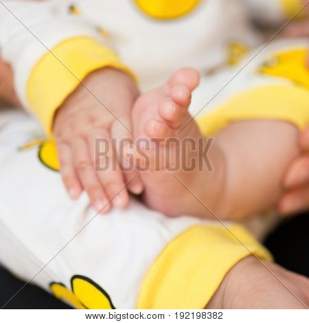 newborn baby hand and foot square composition