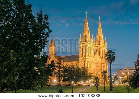 St. Peter's Cathedral of Adelaide lit up at night South Australia. View from Pennington Gardens