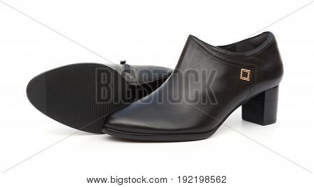 pair of trendy black shoes for lady on a white background
