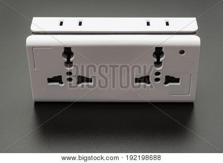 A multi-sockets universal adapter on black background