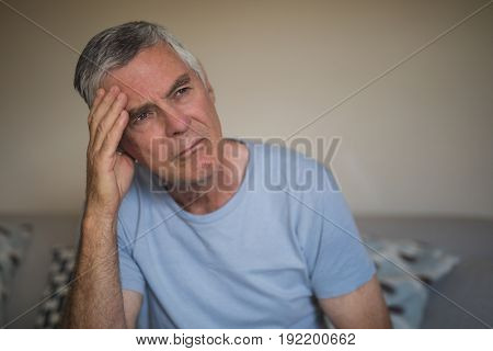 Close up of sad thoughtful senior man at home