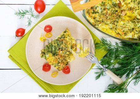 Cauliflower baked with cheese greens and egg. A large piece on a plate. Proper nutrition. Dietary menu. Vegetarian cuisine. The top view