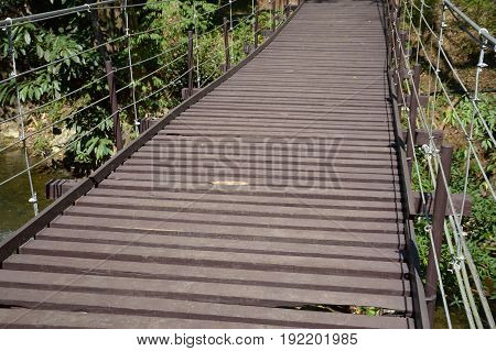 wood sling bridge in forest at Kanchanaburi Thailand