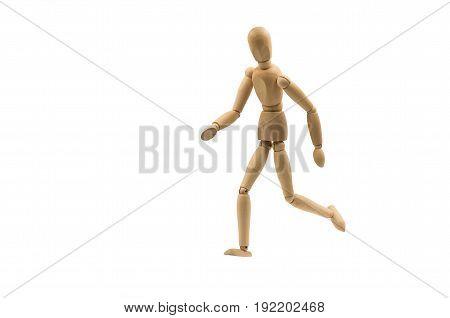 running wooden man puppet on white background