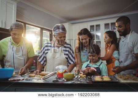 Happy family preparing dessert in kitchen at home