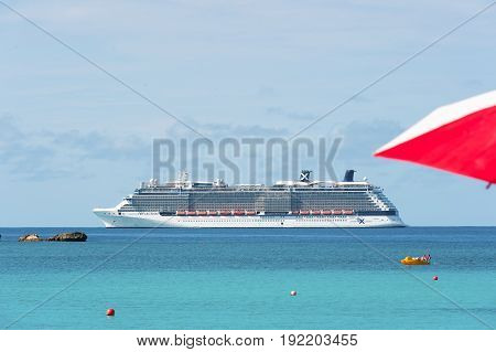 Great stirrup cay Bahamas - January 8 2016: luxury white cruise ship or passenger liner in turquoise sea or ocean water on sunny day on idyllic blue sky. Travelling traveling. Summer vacation
