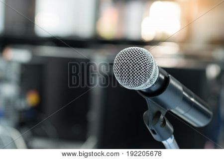soft focus Microphone on blur abstract background lecture hall seminar meeting room in business event