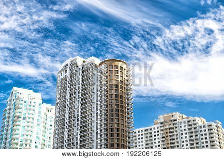 modern luxury expensive building exteriors in Miami. florida against blue sky at sunny day