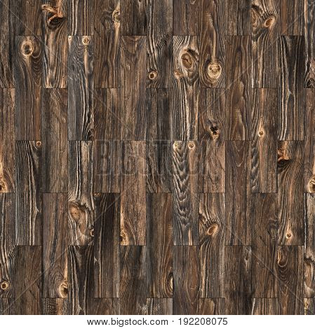 Background of rustic parquet wood grain texture with knots which can be tiled in a seamless pattern.