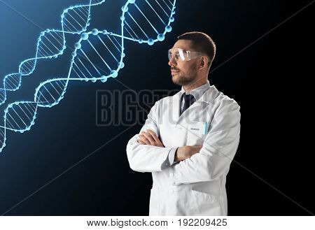 science, genetics and people concept - male doctor or scientist in white coat and safety glasses with dna molecule over black background