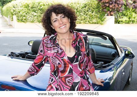 Curly Brunette Girl With Convertible Cabriolet Car In Summer Day