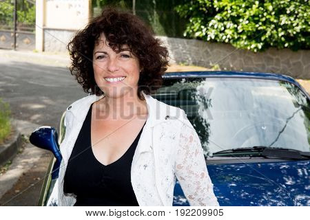 Happy Woman In Summer With Car Background