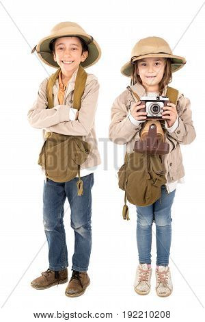 Young couple with a camera playing Safari isolated in white