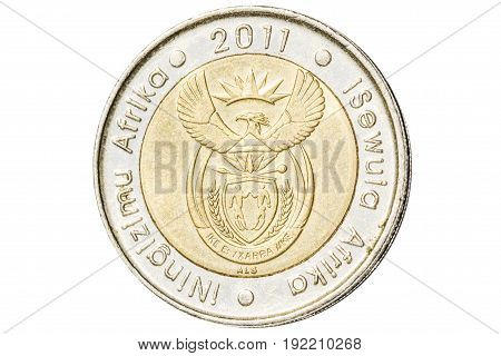 South African five rand coin introduced in 2004 closeup with symbol of coat of arms of South Africa. Isolated on white studio background.