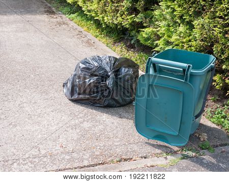 Rubbish And Bin Outside House