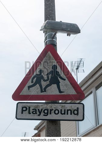 Triangle Playground Sign In Street Close Up
