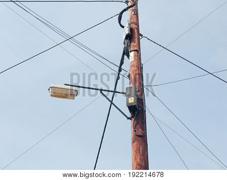 Wooden Post With Wires And Boxes