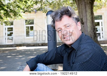 a forties cheerful man outdoor in city