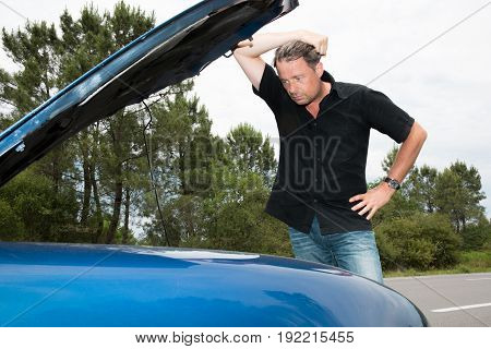Cheerful Forties Man Have Trouble With Car On Road Travel