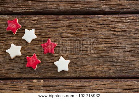 Red and white sugar cookies arranged on wooden table for 4th of July