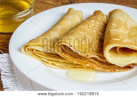 Pancakes With Honey Syrup On A White Plate. Traditional Crepe Or Pancake