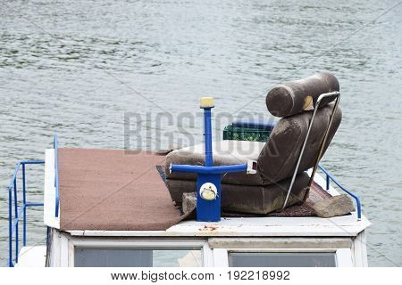 An old armchair on the roof of the boat cab - an unexpected place for one armchair