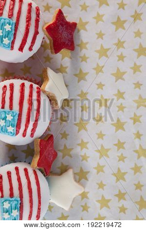 Close-up of decorated cupcakes arranged on table