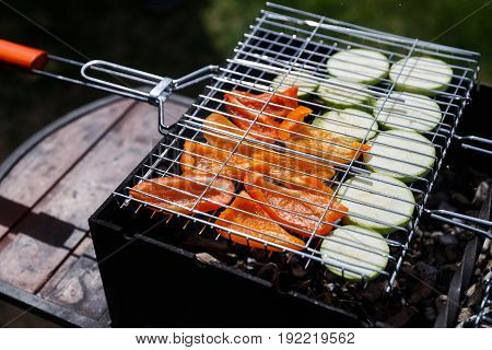 Vegetables barbecue on grill in summer on wooden table