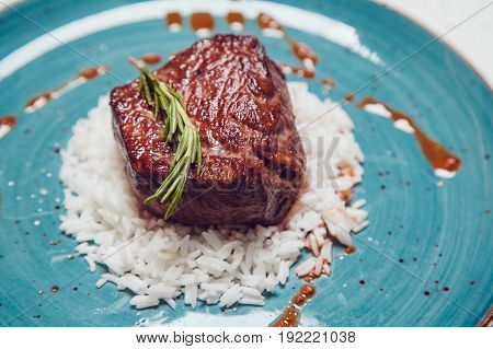 Delicious beef grilled whith rice. Food photo.