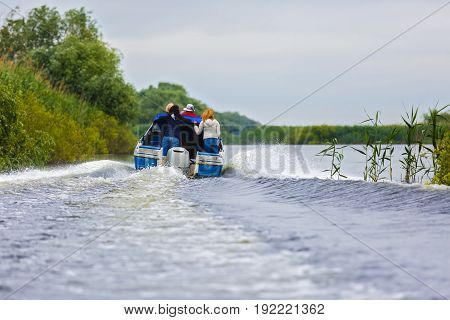 Boat with tourists in the Danube Delta