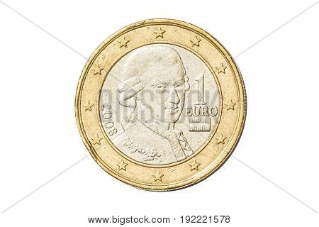 Austrian coin of one euro closeup with symbol head of Wolfgang Amadeus Mozart, the famous Austrian composer from Austria. Isolated on white studio background.