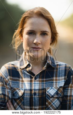 Close up portrait of beautiful young woman at farm