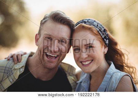 Close up portrait of cheerful young couple at olive farm