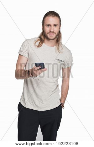 Young Blond Man Using Smartphone And Looking At Camera, Isolated On White