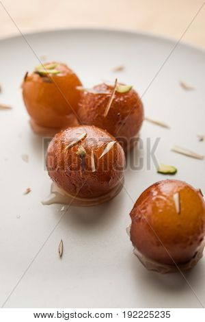 Indian Sweet food called Gulab Jamun made up of milk and sugar, a popular dish in festival or special occasion. Selective focus