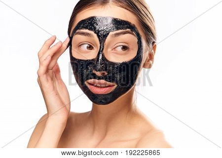 Woman on isolated background, black mask for face, girl on white background, beauty, health.