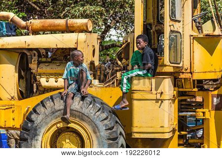Antsiranana Madagascar - December 20 2015: Unidentified Malagasy boys sit on the tractor and talk in Antsiranana (Diego Suarez) Madagascar Africa.