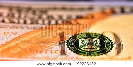 Macro shot on the 100 USD bill with narrow field of view and the balance partially in focus