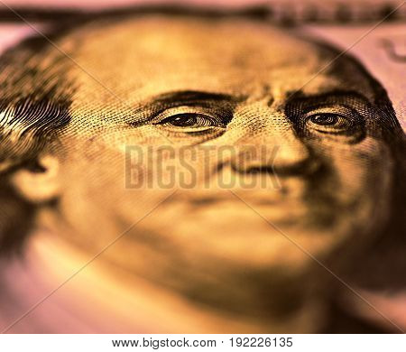 Benjamin Franklin. Eyes in focus on obverse of the 100 US dollar bill