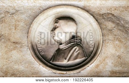 ROME, ITALY - SEPTEMBER 03: Blessed Duns Scotus, bass relief in portico of church dei Santi XII Apostoli in Rome, Italy on September 03, 2016.