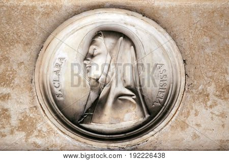 ROME, ITALY - SEPTEMBER 03: Saint Clare of Assisi, bass relief in portico of church dei Santi XII Apostoli in Rome, Italy on September 03, 2016.