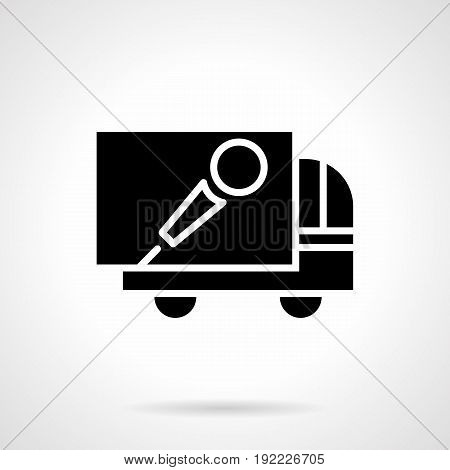 Abstract monochrome symbol of truck with microphone sign. Elements of outdoor advertising for concerts, show, music festival. Symbolic black glyph style vector icon.