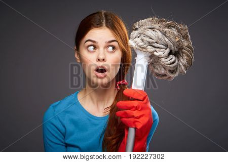 Cleaning, cleaning woman, cleanliness, woman in gloves, woman on black background.