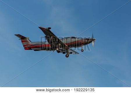 Single turboprop aircraft landing aircraft. Single-propeller aircraft flying over the runway at a small airport