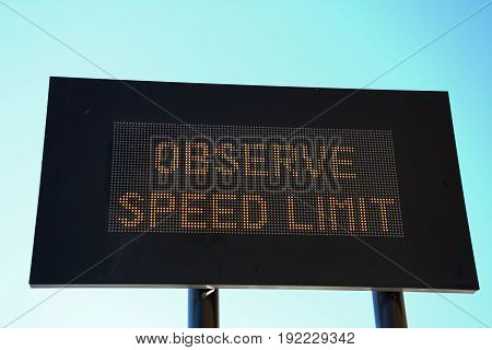 LED Observe speed limit sign with a black border against a blue sky Valletta Malta Europe.