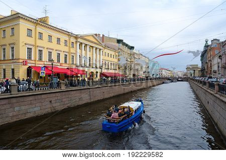 SAINT PETERSBURG RUSSIA - MAY 1 2017: Unknown tourists are on sightseeing boat on Griboyedov Canal St. Petersburg Russia