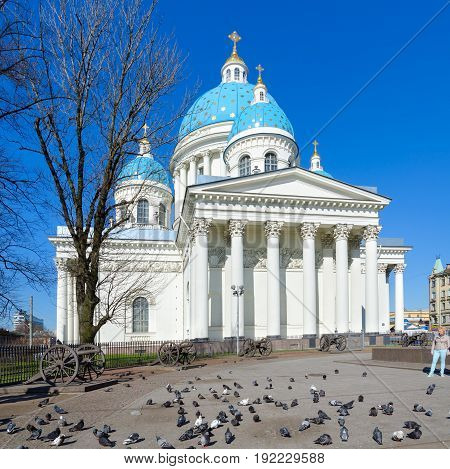 SAINT PETERSBURG RUSSIA - MAY 2 2017: Unknown woman is near Cathedral of Holy Life-Giving Trinity of Life Guards of Izmailovsky Regiment (Troitse-Izmailovsky Cathedral Trinity Cathedral) St. Petersburg