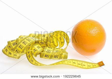 Wavy Yellow Tape For Measuring And Ripe Orange Fruit