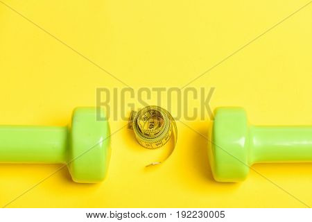 Tape For Measuring In Yellow Colour With Juicy Green Dumbbells
